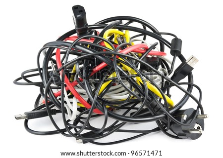 Big chaotic knot of mixed cables on white - stock photo