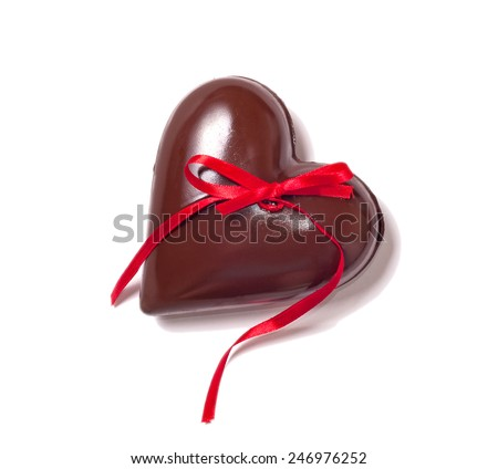 big chocolate heart and red ribbon on white, love concept