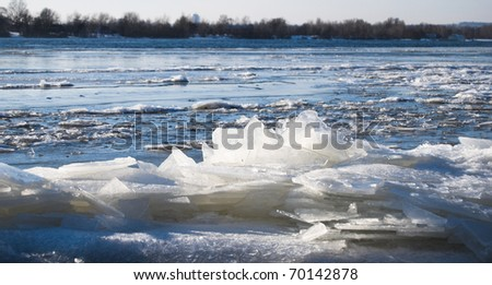 big chunk of ice in the river Dniepr (Dnipro) on a winter day, near a coast