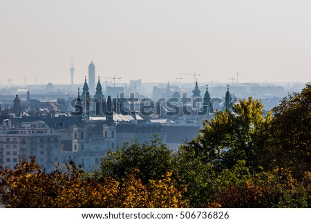 Big city panoramic view with construction site and church towers