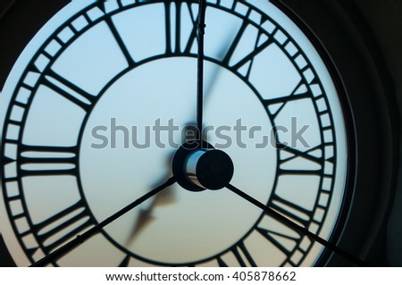 Big city tower clock with roman numerals on dial  - stock photo