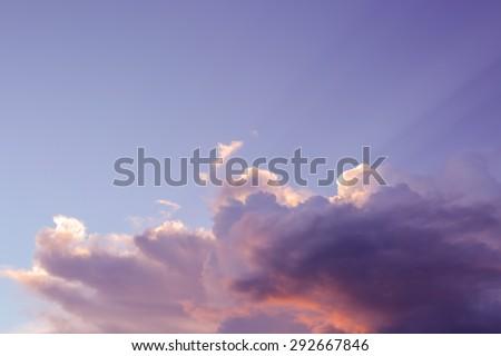 Big cloud against sunlight on beautiful sky - stock photo