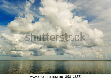 Big clouds above Baltic sea. - stock photo