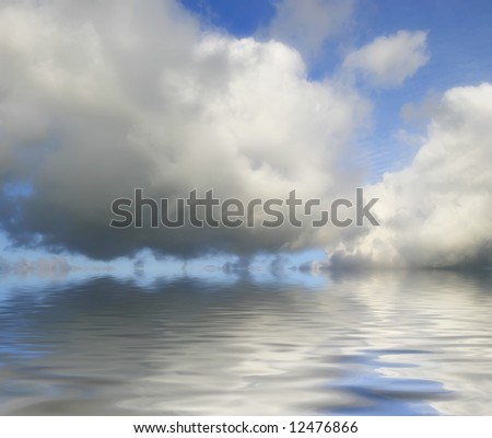 big clouds reflected from the water - stock photo