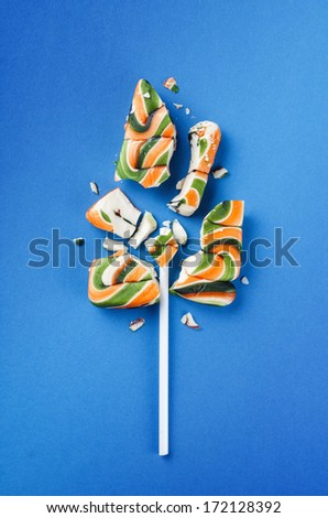 Big colorful lollipop candy broken in pieces  - stock photo