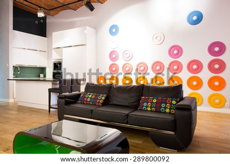 Big Comfortable Leather Couch With Colorful Pillows