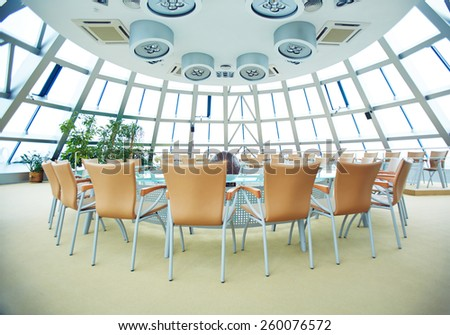 Big conference hall with round table - stock photo