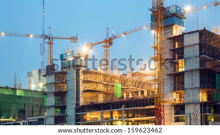 Big Construction Site Cranes at dusk - stock photo