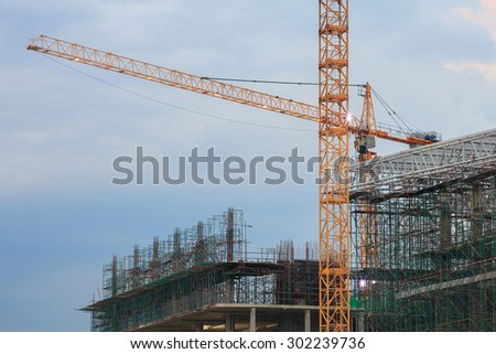 Big Construction Site with Working Cranes at Night.