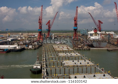 Big container ship entering to dry dock - stock photo