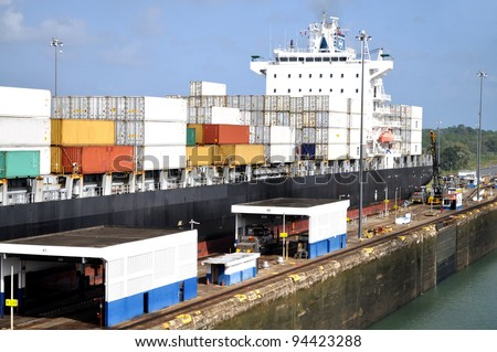 Big container ship in a sluice gate in the Panama canal - stock photo