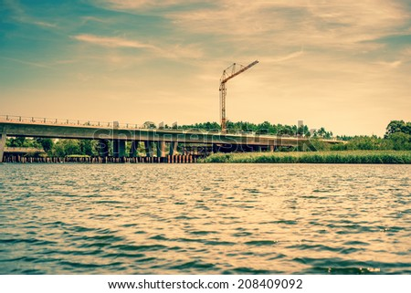 Big crane at a bridge construction - stock photo