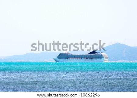 Big cruise liner goes into the open sea. - stock photo