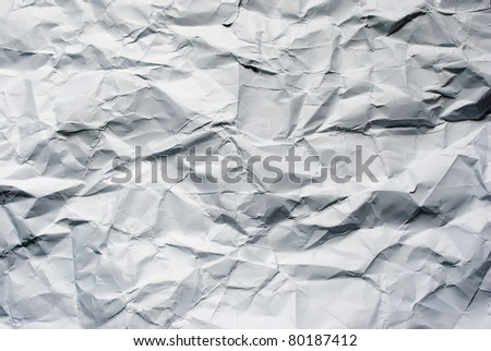 Big crumpled paper background for art design. - stock photo