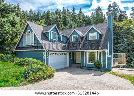 Big custom made luxury house with nicely landscaped and trimmed front yard in the suburbs of Vancouver, Canada. - stock photo