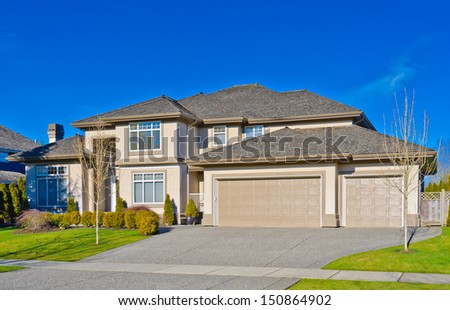 Big custom made luxury house  with two double doors garages in the suburbs of Vancouver, Canada. - stock photo