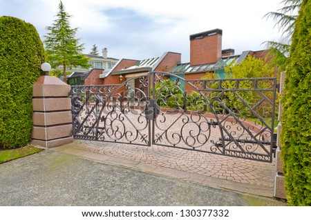 Big custom made luxury  luxury house, residence behind the gates in the suburbs of Vancouver, Canada. - stock photo