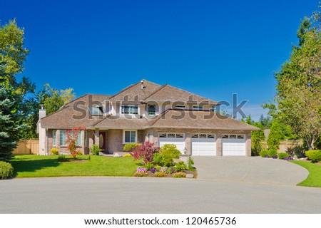 Big custom made three doors garage luxury house in the suburbs of Vancouver, Canada. - stock photo
