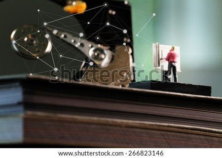 Big data concept-miniature engineer working with drafting table with open hard-disk background - stock photo