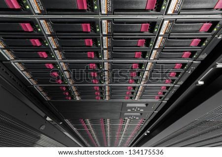 Big data serer in rack with multiple hard drives. - stock photo