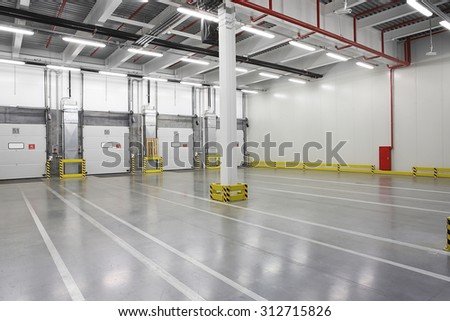 Big distribution warehouse with gates for loading goods - stock photo