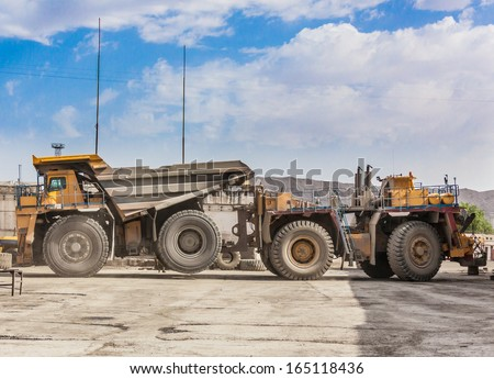 big dump truck at repair plant  - stock photo
