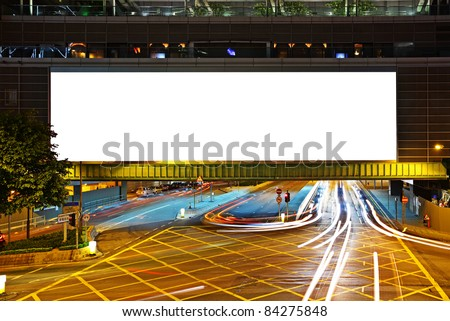 big empty billboard at night in city - stock photo