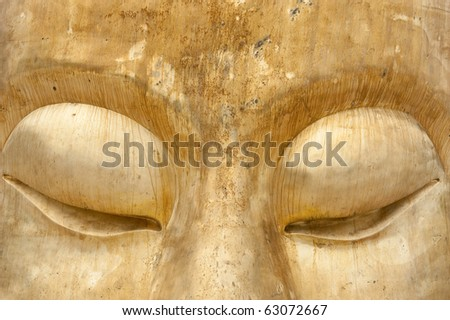 Big eyes of Buddha at Huay Mongkol temple - stock photo