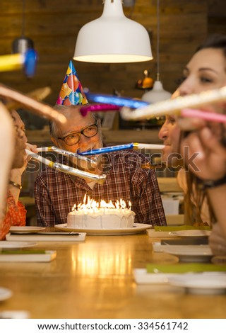 Big family celebrate the birthday of the grandfather - stock photo