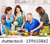 Big family cooking at kitchen. Grandfather and grandmother. - stock photo