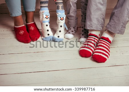 Big family of father, mother, sister, brother in Christmas socks - stock photo