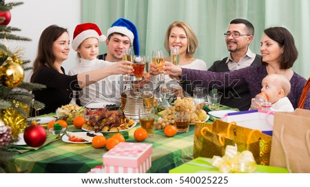 Big Family Together With Mom And Dad Celebrating Christmas At Festive Table
