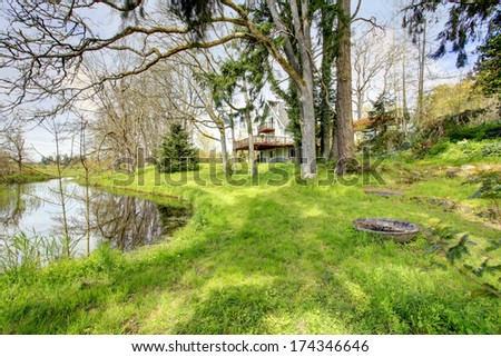 Big farmhouse with deck. Backyard view on lake and landscape