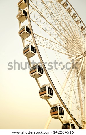 Big ferris wheel against  blue sky.Processed with vintage style. - stock photo