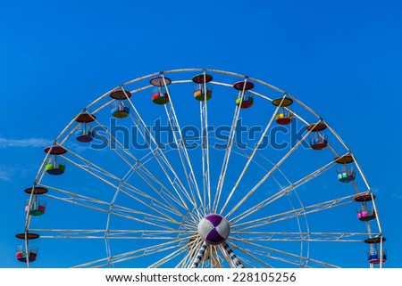 big ferris wheel on blue sky background - stock photo
