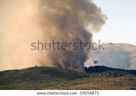Big fire in the north of Portugal mountains seeing canadair plane in action - stock photo