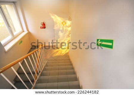 Big fire on the stair case - stock photo