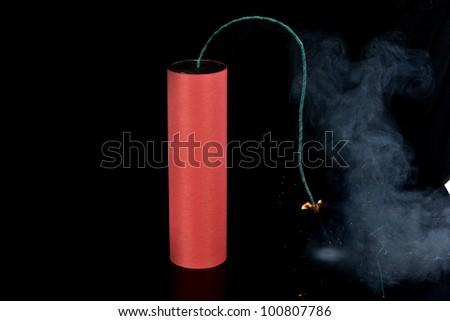 Big Firecracker on black - stock photo
