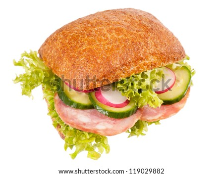 Big fresh graham roll sandwich with vegetables and sausage mix, healthy food of lettuce, cucumber and radish isolated on white background, object in horizontal orientation, nobody. - stock photo
