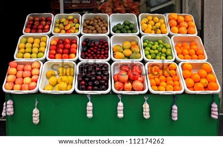 Big fruit stand in front of grocery store - stock photo