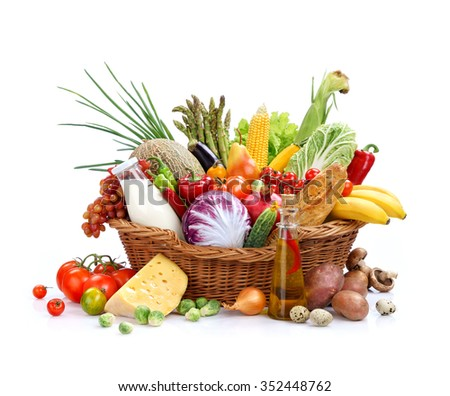 Big full basket of healthy food / studio photography of basket with foodstuff - on white background. High resolution product - stock photo