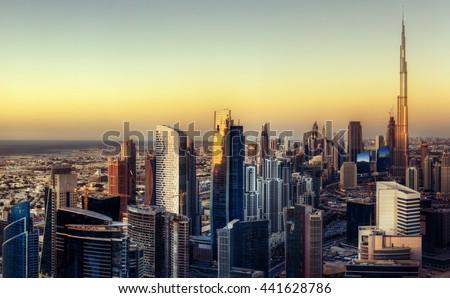 Big futuristic city at colorful sunset. Fantastic skyline of Dubai, UAE.  - stock photo