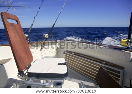 Big game boat wooden fishing chair for tuna wahoo and marlin - stock photo