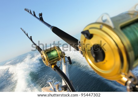 big game fishing reels and rods - stock photo
