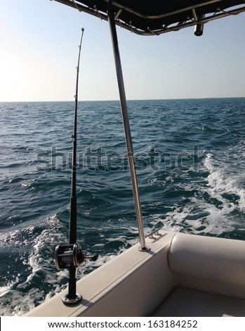 Big game fishing reels and rods in the ocean - stock photo