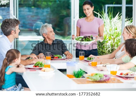 big generation family, parents, children and grandparents, happy smile lunch dinner at table, home - stock photo