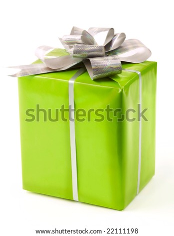 Big giftbox bounded with silver ribbon and decorated with nice knot - stock photo