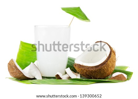 Big glass of coconut milk with coconuts on a white background - stock photo
