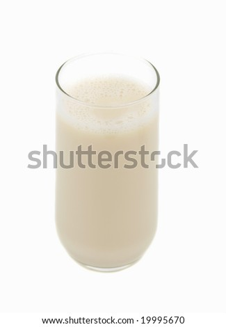 big glass of natural soy beverage, white background - stock photo