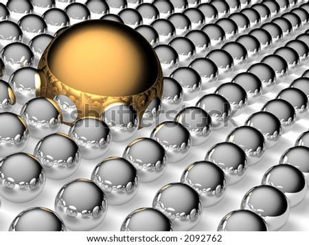 Big gold and small steel balls - stock photo